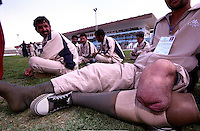 A disable athlete takes is prosthesis off after playing football at Ghazi Stadiun, Kabul..On 23-25 August 2005, Special Olympics Afghanistan held its first national Games at Olympic Stadium in Kabul. More than 300 athletes, including 80 female athletes, experienced a taste of happiness and achievement for the first time in their lives. They competed in athletics, bocce and football (soccer). Because of cultural restrictions, males and females competed at separate venues.