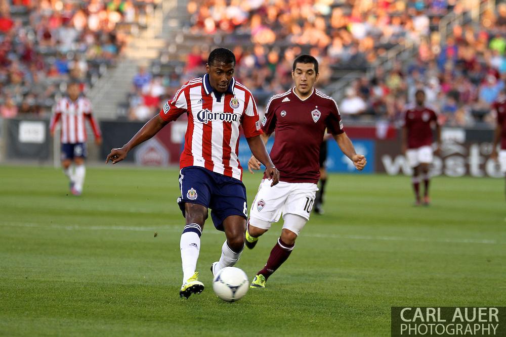 August 18th, 2012: Chivas USA midfielder Oswaldo Minda (8) and Colorado Rapids midfielder Martin Rivero (10) in the first half at Dick's Sporting Goods Park