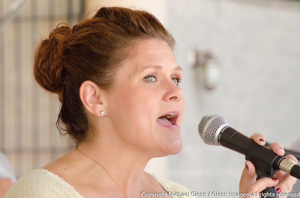 19 Sep 2015 Staten Island, New York US // The National Anthem is sung by Michele Cleary at the 8th annual Lt. John Martinson Memorial Picnic at the Hillside Swim Club //  Michael Glenn  /   for the FDNY