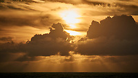 Sun Rising through the Clouds from the Deck of the MV Explorer. Image taken with a Nikon 1 V1 camera and 30-110 mm lens (ISO 100, 110 mm, f/16, 1/200 sec).