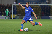 AFC Wimbledon defender Nesta Guinness-Walker (18) crossing the ball during the EFL Sky Bet League 1 match between AFC Wimbledon and Gillingham at the Cherry Red Records Stadium, Kingston, England on 23 November 2019.