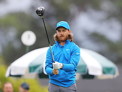 April 7, 2018 - Augusta, GA, USA - Tommy Fleetwood prepares to hit from the 1st tee during the third round of the Masters Tournament on Saturday, April 7, 2018, at Augusta National Golf Club in Augusta, Ga. (Credit Image: © Curtis Compton/TNS via ZUMA Wire)