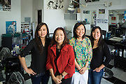 Tina's Hair Design employees Helen Do, Jennifer Lu, Hue Luu, (left to right) and owner Tina Chang (red) pose for a portrait inside Tina's Hair Design in Milpitas, California, on September 11, 2014. (Stan Olszewski/SOSKIphoto)