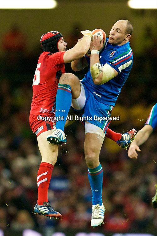 01.02.2014 Cardiff, Wales. Wales fullback Leigh Halfpenny (Cardiff Blues) and Italy number 8 Sergio Parisse (Stade Français) during the Six Nations game between Wales and Italy from the Millennium Stadium.