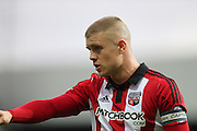 Brentford defender Jake Bidwell during the Sky Bet Championship match between Brentford and Brighton and Hove Albion at Griffin Park, London, England on 26 December 2015.