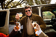 Fox Hunt followers enjoy a glass of champagne before the start of the hunt at Middleton Place plantation in Charleston, SC.