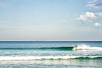 Homem surfando na Praia dos Açores. Florianópolis, Santa Catarina, Brasil. / Man surfing at Acores Beach. Florianopolis, Santa Catarina, Brazil.