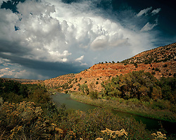 Rapidly forming thundercloud in western Colorado, near the San Miguel River