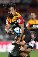 Chiefs' Tana Umaga offloads in the tackle of Sharks' Meyer Bosman. Super 15 rugby union match, Chiefs v Sharks at Waikato Stadium, Hamilton, New Zealand. Friday 18th March 2011. Photo: Anthony Au-Yeung / photosport.co.nz