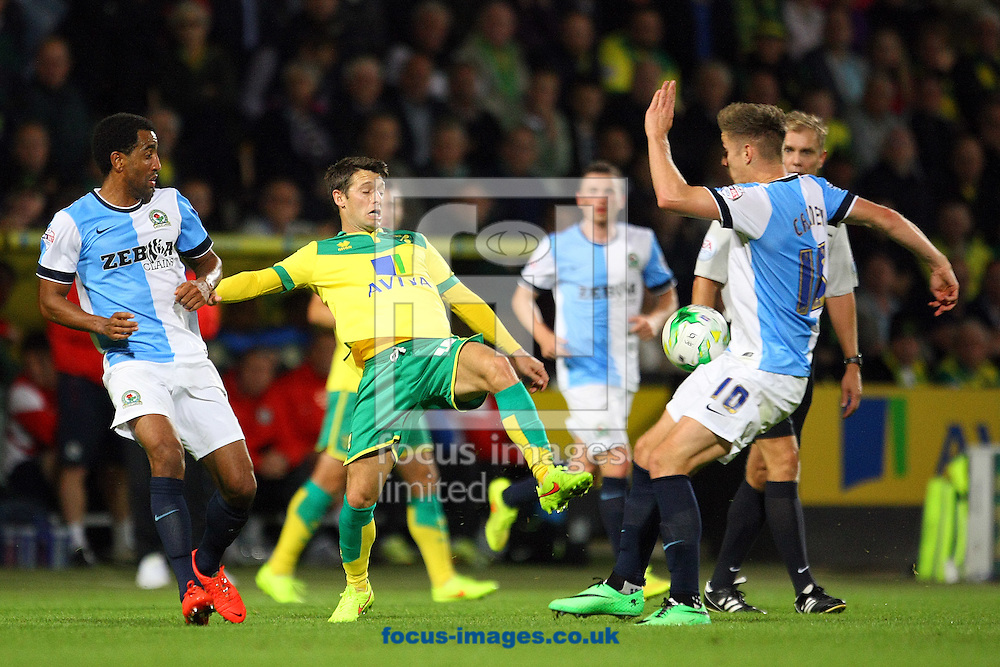 Wes Hoolahan of Norwich and Chris Brown of Blackburn Rovers in action during the Sky Bet Championship match at Carrow Road, Norwich<br /> Picture by Paul Chesterton/Focus Images Ltd +44 7904 640267<br /> 19/08/2014