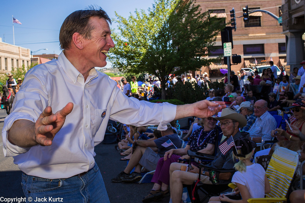 30 JUNE 2012 - PRESCOTT, AZ:   Dr. PAUL GOSAR, a dentist and a Republican member of Congress from Flagstaff, AZ, works the crowd for his reelection campaign at the Prescott Frontier Days Rodeo Parade. Prescott is solidly Republican and the parade is popular with Republican political candidates. Gosar is facing a primary challenge from Ron Gould, an Arizona legislator. The parade is marking its 125th year. It is one of the largest 4th of July Parades in Arizona. Prescott, about 100 miles north of Phoenix, was the first territorial capital of Arizona.   PHOTO BY JACK KURTZ