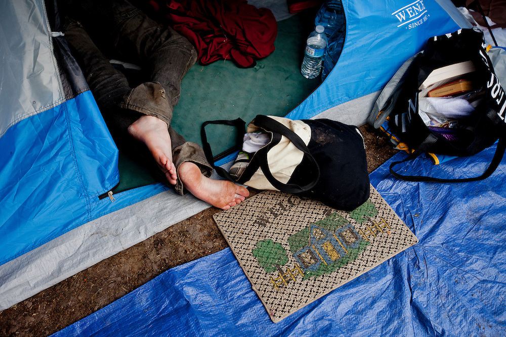 The entrance to a weary Occupy LA protesters tent on the morning after demonstrations in Los Angeles, Calif. on Monday, November 28, 2011. (Photo by Gabriel Romero ©2011)