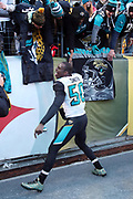 Jacksonville Jaguars outside linebacker Telvin Smith (50) high fives Jaguars fans as he celebrates while running off the field after the Jaguars win the NFL 2018 AFC Divisional playoff football game against the Pittsburgh Steelers, Sunday, Jan. 14, 2018 in Pittsburgh. The Jaguars won the game 45-42. (©Paul Anthony Spinelli)