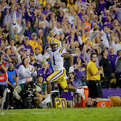 Oct 12, 2019; Baton Rouge, LA, USA; LSU Tigers wide receiver Ja'Marr Chase (1) runs after a catch for a touchdown during the fourth quarter at Tiger Stadium. Mandatory Credit: Derick E. Hingle-USA TODAY Sports