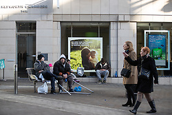 © Licensed to London News Pictures . 24/10/2018. Leeds , UK . People sitting on benches and in shop windows amongst anti-homeless spikes , on Briggate in Leeds City Centre . At least six people sleeping rough have died in the Metropolitan Borough of the City of Leeds since March 2017 and West Yorkshire Police say they responded to 66 reported cases of people suffering the effects of Spice in July 2018 , a large increase on previous months . Photo credit : Joel Goodman/LNP