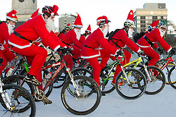 © under license to London News Pictures.  18/12/2010 Bikers from a local Plymouth bike club dressed as Santa cycle along a snow covered Plymouth Hoe this morning (18/12/2010). Snow and cold weather has hit much of the South West of England. Picture credit should read: David Hedges/LNP.