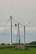 The remains of an old agricultural wind mill stands amidst new power generating wind turbines near Bad Axe Michigan.