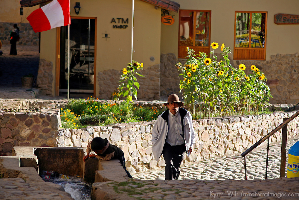 South America, Latin America, Peru, Urubamba Valley. Daily life in the quaint Incan streets of Ollanta (Olantaytambo).