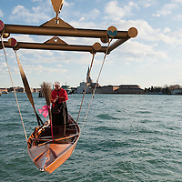 VENICE, ITALY - JANUARY 06:  A rover stands on his boat while is launhed in the lagoon ahead of the 34th  Befana Regata on January 6, 2012 in Venice, Italy.  In Italian folklore, Befana is an old woman who delivers gifts to children throughout Italy on the feast of the Epiphany on January 6 in a similar way to Saint Nicholas or Santa Claus.