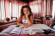 Lampedusa, Italia - 3 luglio 2011. Mariangela Greco, 28 anni, lampedusana, proprietaria di un B&B a Lampedusa controlla le prenotazioni di luglio, agosto e settembre 2011. Dopo l'emergenza immigrazione molte delle prenotazioni sono andate perse e la richiesta di stanze è calata di circa il 70% rispetto alle scorse stagioni estive..Ph. Roberto Salomone Ag. Controluce