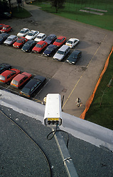 CCTV security camera overlooking car park in secondary school; London UK