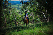 Young Woman riding a horse in Australian Bush, Hunter Valley, Australia