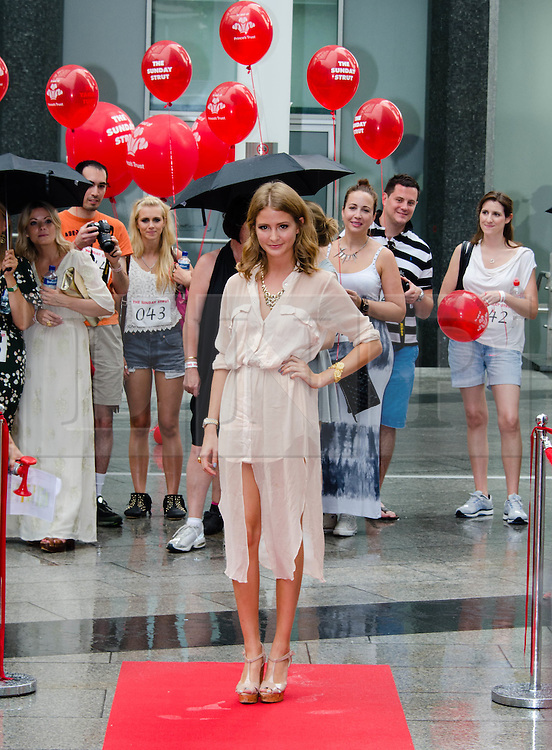 © Licensed to London News Pictures. 19/08/2012. London,UK.  Millie Mackintosh, of reality TV show Made in Chelsea, participating in exclusive fundraising walk The Sunday Strut, in aid of The Princes Trust. Photo credit : Richard Isaac/LNP