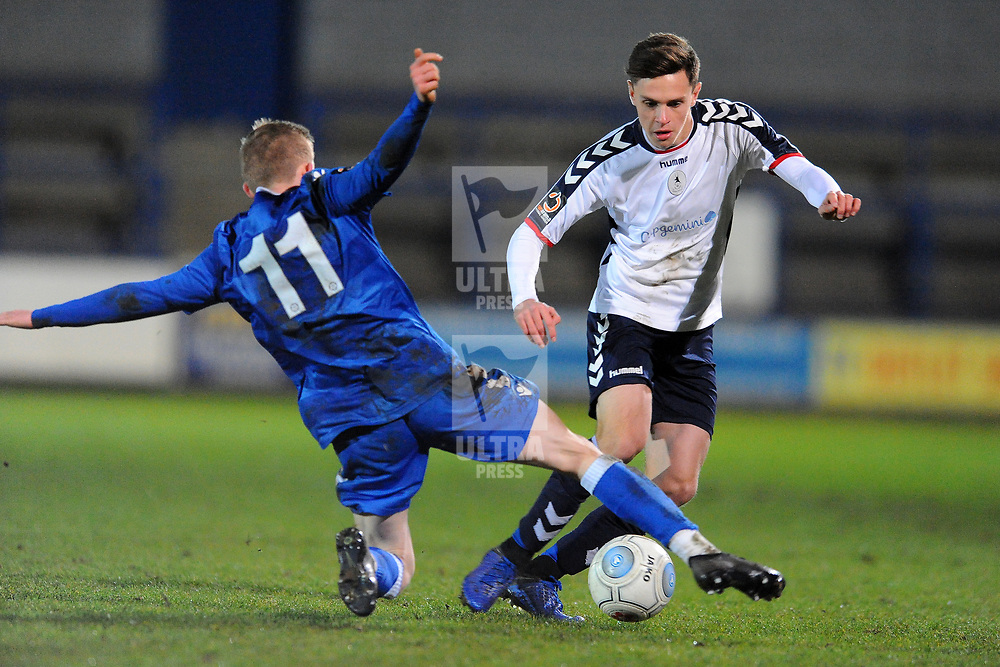 TELFORD COPYRIGHT MIKE SHERIDAN 12/2/2019 - Ryan Barnett of AFC Telford (on loan from Shrewsbury Town Football Club) is tackled by Scott Smith during the Vanarama Conference North fixture between AFC Telford United and Guiseley at the New Bucks Head.