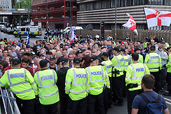 Britain First supporters are contained by police in Navigation Street, Birmingham, where an estimated 250 supporters of the party were escorted by police on a short route through the city centre, with a similar number of people attending nearby counter-protests.