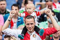 ROTTERDAM - Eerste training van Feyenoord , voetbal , seizoen 2015-2016 , Stadion De Kuip , 28-06-2015 , Jonge fan samen met zijn vader op de tribune