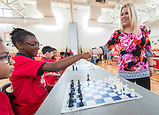 Kailee Bradford shakes hands with chess grandmaster Susan Polgar at the start of their game at Ryan Middle School, September 15, 2014.