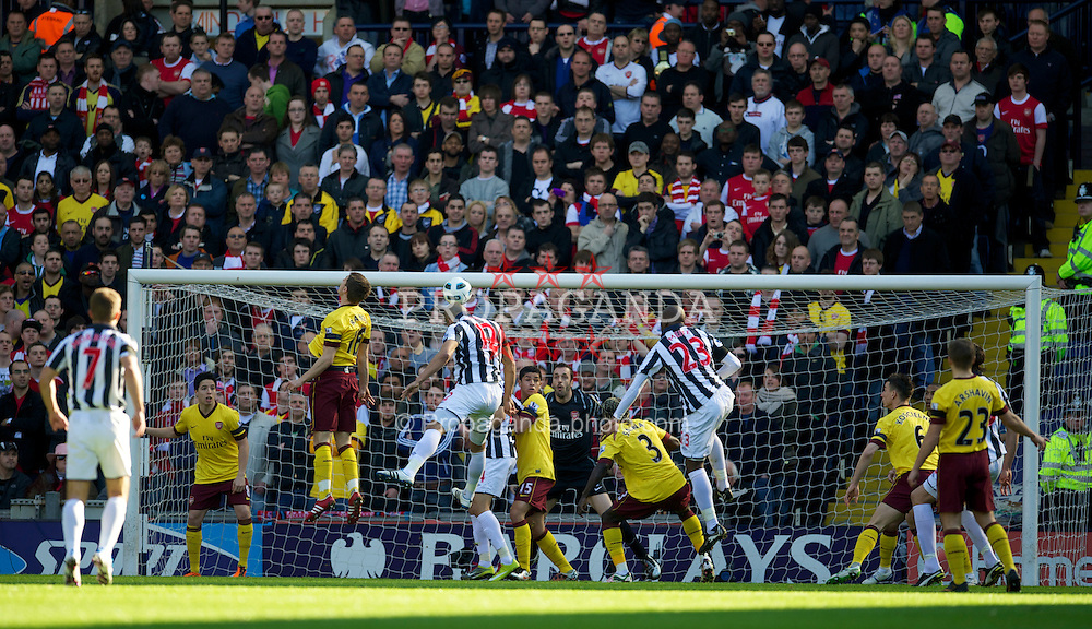 WEST BROMWICH, ENGLAND - Saturday, March 19, 2011: West Bromwich Albion's Steven Reid scores the first goal past Arsenal's goalkeeper Manuel Almunia during the Premiership match at the Hawthorns. (Photo by David Rawcliffe/Propaganda)