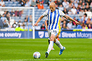 Aaron Mooy of Huddersfield Town (10) in action during the EFL Sky Bet Championship match between Huddersfield Town and Derby County at the John Smiths Stadium, Huddersfield, England on 5 August 2019.