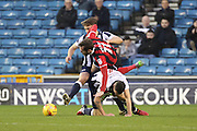 Scramble for the ball during the EFL Sky Bet League 1 match between Millwall and Shrewsbury Town at The Den, London, England on 10 December 2016. Photo by Matthew Redman.
