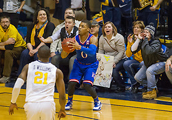 Kansas Jayhawks guard Frank Mason III (0) makes a three pointer against the West Virginia Mountaineers during the second half at the WVU Coliseum.