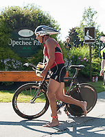 Bruce Butterworth enters the transition area at Opechee Park during GLCAC's Marshmallow Man Trathlon on Sunday morning.  (Karen Bobotas/for the Laconia Daily Sun)