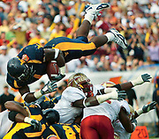 West Virginia running back Kay-Jay Harris (1) goes over the top for a one-yard touchdown to put the Mountaineers ahead of Florida State in the first half during the Gator Bowl at Alltel Stadium on Saturday, Jan. 01, 2005 in Jacksonville, Fla. FSU won 30-18. (Craig Litten/Daytona Beach News-Journal)