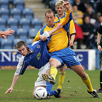 Queen of the South v St Johnstone..30.04.05<br />Paul Sheerin battles with Brian McColligan<br /><br />Picture by Graeme Hart.<br />Copyright Perthshire Picture Agency<br />Tel: 01738 623350  Mobile: 07990 594431
