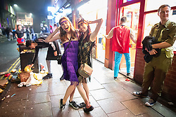 © Licensed to London News Pictures . 27/12/2018. Wigan, UK. Identical twins HANNAH and ABI DILLON (22) on King Street . Revellers in Wigan enjoy Boxing Day drinks and clubbing in Wigan Wallgate . In recent years a tradition has been established in which people go out wearing fancy-dress costumes on Boxing Day night . Photo credit: Joel Goodman/LNP