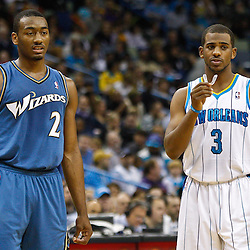 February 1, 2011; New Orleans, LA, USA; Washington Wizards point guard John Wall (2) and New Orleans Hornets point guard Chris Paul (3) stand on the court during the second quarter at the New Orleans Arena.   Mandatory Credit: Derick E. Hingle