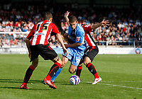 Photo: Richard Lane/Richard Lane Photography. Wycombe Wanderers v Brentford. Coca Cola Fotball League Two. Wycombe's John Mousinho cuts through the Brnetford defence.