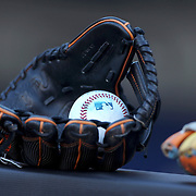 NEW YORK, NEW YORK - APRIL 12: A baseball in a baseball mitt on the dugout fence before the Miami Marlins Vs New York Mets MLB regular season ball game at Citi Field on April 12, 2016 in New York City. (Photo by Tim Clayton/Corbis via Getty Images)