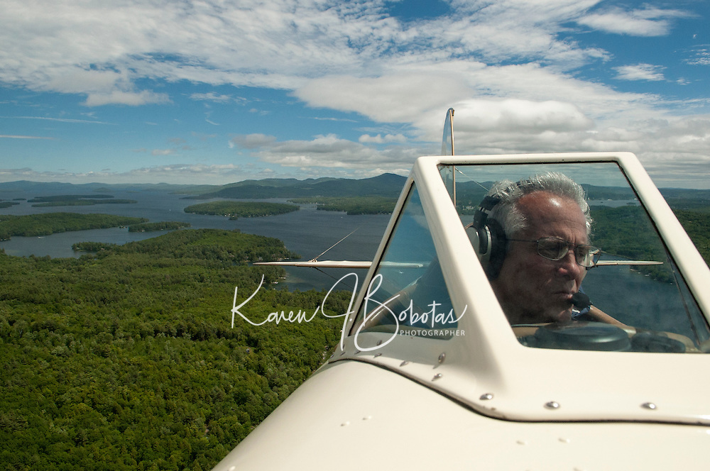 Flight over Lake Winnipesaukee with Lakes Biplane June 8, 2013.  Karen Bobotas Photographer