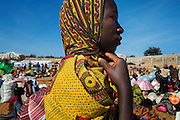 Kigoma, Tanzania - 2015-05-22 - A young Burundian refugee waits with thousands of others in the Lake Tanganyika stadium in Kigoma, Tanzania on May 22, 2015. As many as 40,000 Burundian refugees were crowded along an 800 metre stretch of shoreline in Kagunga, a 3 hour boat ride north of Kigoma. The UNHCR has been transporting 2,000 refugees per day to Kigoma by boat and then on to Nyarugusu refugee camp by bus.   Photo by Daniel Hayduk
