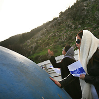 Jewish women pray on the roof of the grave of Yonatan ben Uziel at Amukah in the Galilee in Israel. Over the centuries the tradition developed that those seeking for their soul-mates would be married within one year if they prayed at Rabbi Ben-Uziel's tomb.