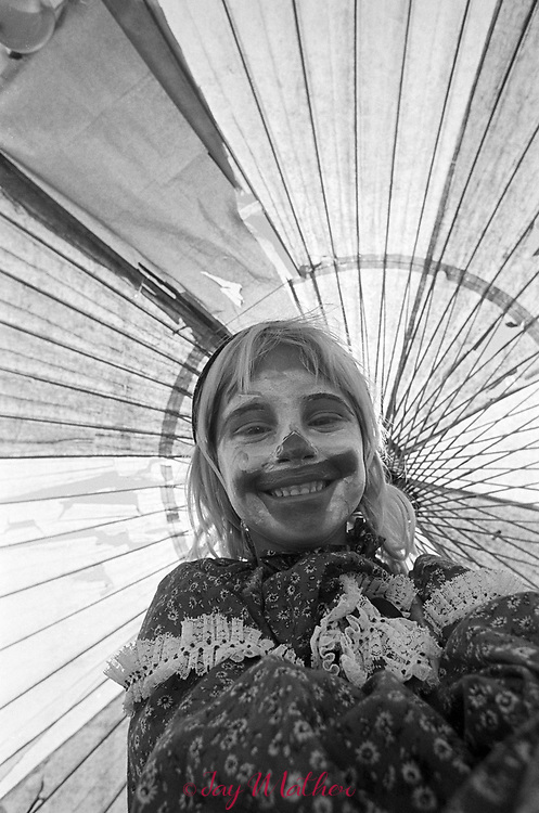 A clownish young girl at the annual Broomfield, CO Halloween costume parade, 1974.