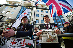 © London News Pictures. 26/02/2014. London, UK.  Veterans and supporters of the BNP gather outside the Old Bailey in London where Michael Adebolajo and Michael Adebowale are due to be sentenced for the murder of Fusilier Lee Rigby who was attacked near Woolwich Barracks in south-east London on May 22, 2013. Photo credit: Ben Cawthra/LNP