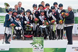 From left to right:<br /> Netherland - Silver; Great Britain - Gold;  German - Bronze<br />   Podium for  Team Para-dressage at the 2014 World Equestrian Games, Caen, Normandy, France..