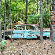 A car at the Old Car City junkyard in Georgia is painted with a No Smoking sign.