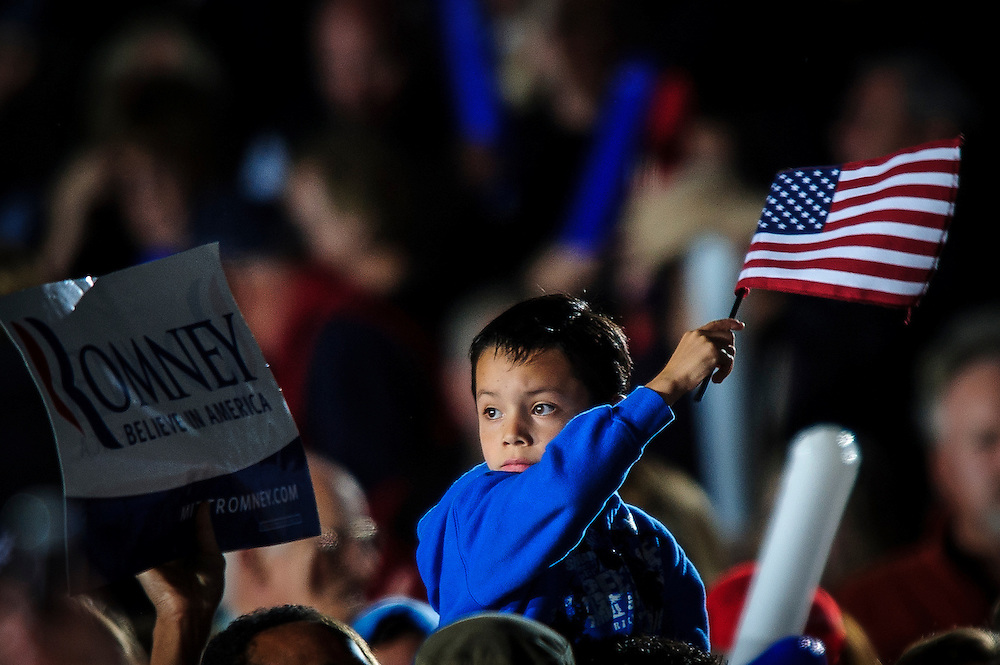 A young boy awaits the Republican Presidential candidate Mitt Romney who was about to speak at a campaign rally in Leesburg , Virginia on Wednesday.